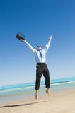 Businessman  on the beach Stock Photography