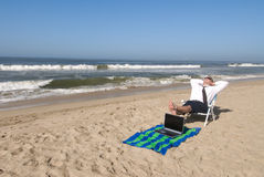 Businessman on beach Stock Images