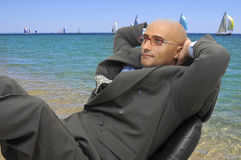 Businessman in the beach Royalty Free Stock Images