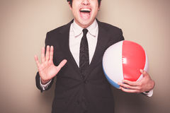 Businessman with beach ball Stock Photography