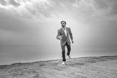 Businessman on the beach, day,outdoor Royalty Free Stock Image