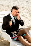Businessman on the beach Stock Photos