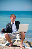 Businessman at the beach Royalty Free Stock Photos