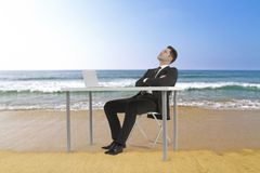 Businessman on beach Stock Photo