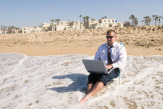 Businessman on beach working Royalty Free Stock Image