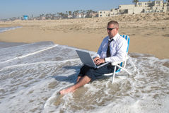 Businessman on beach working royalty free stock photo