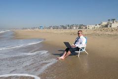 Businessman on beach working Royalty Free Stock Photo