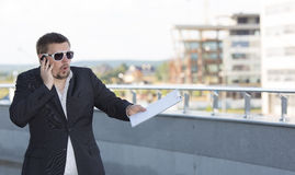 The businessman with a beard speaks by phone Stock Photo