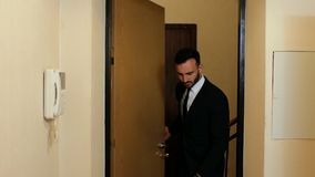 Businessman with a beard and suit and tie enters the office door. 4k. 4k video.  stock video