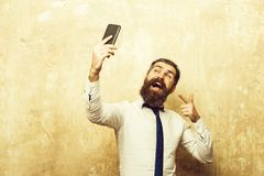 Businessman or bearded man with long beard speaking on phone stock photos