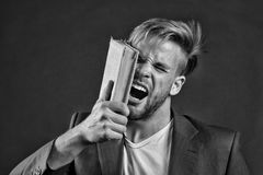 Businessman beat face with book, motivation. Angry man shout with book, knowledge. Motivation power, success. Knowledge information, wisdom. Education Stock Photos