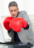 Businessman beating the competition Royalty Free Stock Photo