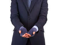 Businessman begging for money. Stock Photography
