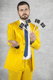 Businessman begs and asks for help. Wearing a gold suit Royalty Free Stock Image