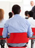 Businessman from behind at a conference Stock Image