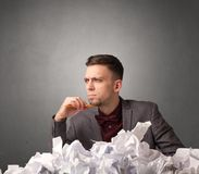 Businessman behind crumpled paper Stock Photography
