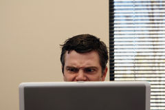 Businessman Behind Laptop - Angry Stock Photo