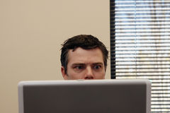Businessman Behind Laptop - Surprised Royalty Free Stock Photography