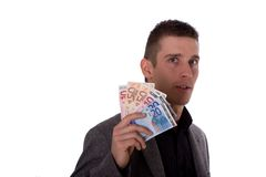 Businessman behind money Royalty Free Stock Images