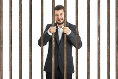 Businessman behind the prison cell Stock Images