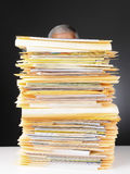 Businessman Behind Stack of Files stock photography