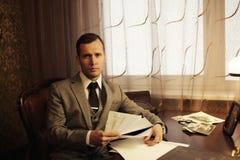 Businessman behind table Stock Photos