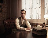 Businessman behind table Stock Photo
