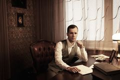 Businessman behind table Stock Image