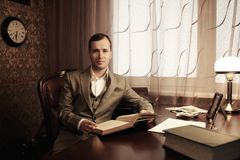 Businessman behind table Stock Photography