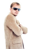 Businessman in beige suit and sun glasses Royalty Free Stock Photography