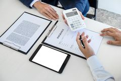 Businessman being analysis and making the decision a car insurance policy, Agent man is holding the calculator and waiting for hi royalty free stock photos