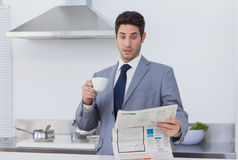 Businessman being astonished when reading the news Stock Photo
