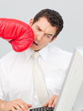 A businessman being boxed in his face Stock Images