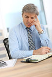 Businessman being concerned stock photography