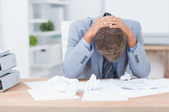 Businessman being depressed by working. In office Stock Photo