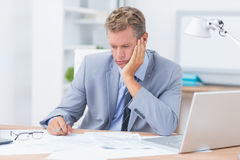 Businessman being depressed by working Royalty Free Stock Photography