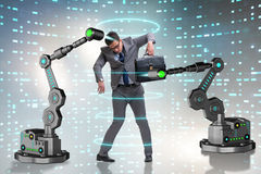 The businessman being manipulated by robotic arms Stock Images