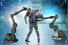 The businessman being manipulated by robotic arms. Businessman being manipulated by robotic arms Stock Images
