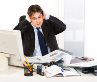 Businessman being overloaded with loads of work Royalty Free Stock Image