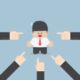 Businessman being pointed by a lot of hands. VECTOR, EPS10 vector illustration