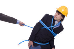 Businessman being pulled by a rope Royalty Free Stock Photo