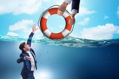 The businessman being saved from drowning. Businessman being saved from drowning stock image
