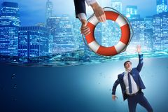 The businessman being saved from drowning. Businessman being saved from drowning stock photos