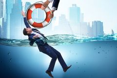 The businessman being saved from drowning. Businessman being saved from drowning royalty free stock photography