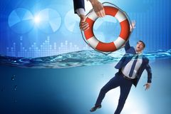 The businessman being saved from drowning. Businessman being saved from drowning stock photography