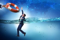 The businessman being saved from drowning. Businessman being saved from drowning royalty free stock image