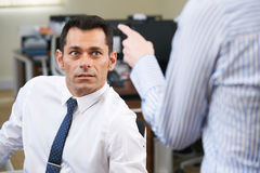 Businessman Being Shouted At By Female Colleague Stock Images