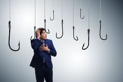 The businessman being tempted to bite the bait royalty free stock photography