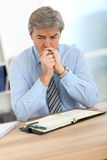 Businessman being thoughtful Royalty Free Stock Images