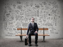 Businessman on a bench Royalty Free Stock Image